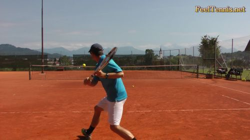 hitting a low ball in tennis