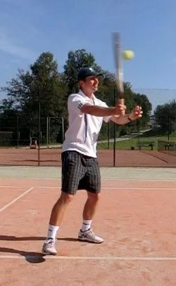 Punching a tennis volley
