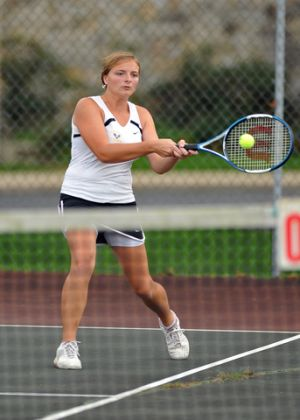 Backhand technique of a club tennis player