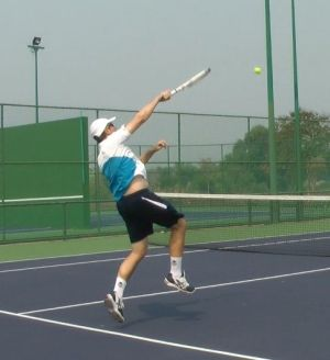 tennis overhead while moving