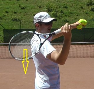 serve racquet drop direction