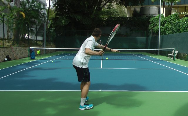 hitting with tennis buddy